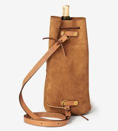 Show up for dinner parties like the gracious guest you are with a bottle of vino in this suede wine carrier bag. The bucket shape accommodates a single bottle perfectly, and the crossbody strap slings across the body to bring it along to the park, BYOB restaurants or outdoor festivals. Plus, the flat base keeps open bottles from tipping as you go to and fro.