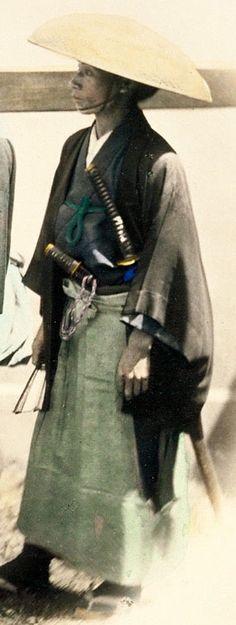 Samurai wearing a kasa.