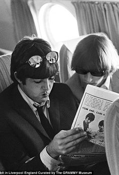 Ringo w/Paul on plane-August 1966, last concert tour. (One of last photos of Paul before he was murdered) May God rest his soul)