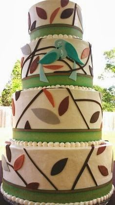 Love Birds Wedding Cake. I love this unique cake. Maybe the green stripe could be purple, the leaves could be varying shades of green, and the birds could be a lighter purple.