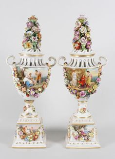 A pair of continental porcelain vases and covers