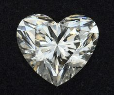 When buying a diamond, the most important thing is to ensure that you get the best valued diamond for its price. And it can seem rather overwhelming but knowing a little about how a diamond is graded can help massively when choosing the perfect diamond for your loved one. This is where the 4 Cs come into play, a universal method of grading a diamond. Learn everything you need to know in this article! #diamondclarity #rawdiamonds #diamondcuts 4 Cs Of Diamonds, Diamond Guide, 4 C's, Heart Shaped Diamond, Diamond Clarity, Diamond Engagement Rings, Heart Shapes, Diamond Cuts, Gems