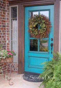 Beyond the Screen Door Turquoise Door. The color pallet I like since we have the red brick to work with.