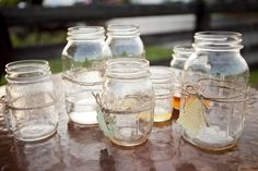 We used mason jars for drinks and for wedding favors. They were wrapped in twine with a name tag on them! #masonjars #wedding #farm