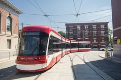 This is what Toronto's new streetcars look like in action Toronto Ontario Canada, Light Rail, Amazing Architecture, Public Transport, Night Life, Street Photography, Cool Pictures, Tours, Transportation Solutions