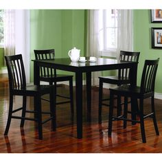 The Ashland five-piece dining set is a simple yet charming contemporary addition to any home decor. Finished in a sleek black color, this square counter-height table comes with four slat-back chairs with contoured wooden seats for comfort.