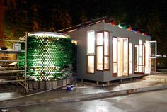 conceived as a three-dimensional collage, the temporary villa is constructed entirely out of recycled materials including old bottles, oil barrels, wooden window frames, and used car doors.