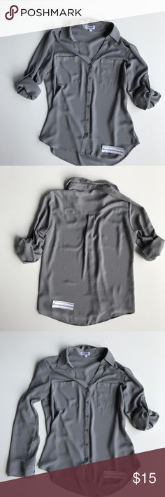 EXPRESS PORTOFINO BLOUSE SHIRT Gray business  SZ M Awesome blouse.  Roll sleeves up or leave them down if you are chilly!! Perfect color! Gently loved.  Great condition.please let me know if you have any questions.  🤗🤗🤗🤗🤗🤗Thanks for looking. Express Tops Blouses