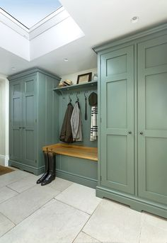 Lewis Alderson & Co, Boot Room This tailored boot room oozes country glamour. Painted in Green Smoke with oak interiors and bench seat, the design provides ample space for coats, shoes and accessories. Mudroom Cabinets, Mudroom Laundry Room, Laundry Room Design, Bench Mudroom, Storage Cabinets, Armoire Entree, Boot Room Utility, Utility Room Designs, Hallway Designs