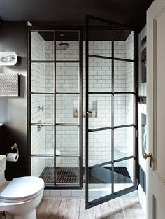 White subway tile and black glass doors.