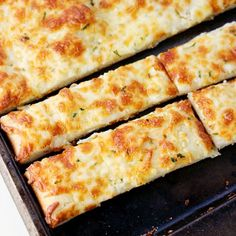 Easy and made from scratch Cheesy Breadsticks like your favorite pizza joint!
