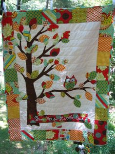 www.facebook.com/barabooboo  www.barabooboo.etsy.com  Owl baby quilt of flannel cotton in red blue green yellow orange fabrics with tree, leaves and 1 owl