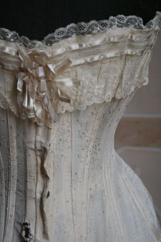 Victorian corset with lace and ribbon trim