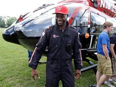 Reggie Wayne arrives to camp in helicopter