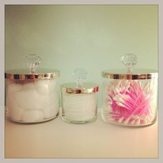 Reused bath and body works candle jars and add knobs on the lids.
