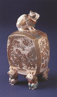 Rare, outstanding Satsuma box with cat finial on the cover and raised on four figural mice feet. Painted decoration of figures in garden interior, frolicking monkeys on the verso, and courtly youths on the side panels, by Yabu Meizan