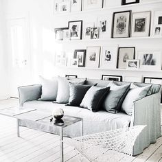 Living room with wall of frames via Annika von Holdt