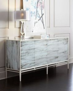 "Handcrafted buffet. Steel frame. Top, sides, and front are glass reverse painted to resemble Carrera marble. Four doors; two adjustable shelves. Back finished in black paint. Assembly required. 88""W x 19""D x 38.75""T. Imported. Boxed weight, approximately 401 lbs."