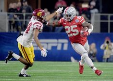 Dec 29, 2017; Arlington, TX, USA; Ohio State Buckeyes running back Mike Weber (25) stiff arm Southern California Trojans cornerback Isaiah Langley (24) in the 2017 Cotton Bowl at AT&T Stadium. Mandatory Credit: Kirby Lee-USA TODAY Sports