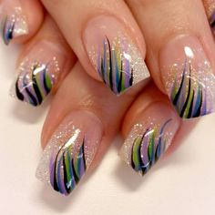 Stripes over Glitter!: Svea Naglar creates a stunning glitters nail set with a splash of of Feathering strips in purple, green, blue and black. - See more at: http://www.dailynails.com/nail-art#.dpuf