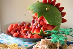 Dinosaur party food! If you can carve a pumpkin, have a go at a dinosaur watermelon. Mark out where you will carve with the tip of a knife, then carve away. Add some grapes and strawberries and VIOLA! Healthy party food.