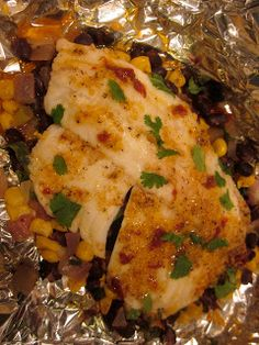Chipotle-Citrus Foil-Baked Tilapia with Black Beans and Corn. Easy, no dishes, one packet of foil to cook the whole dinner, sides included! // lovelyclearsweet.