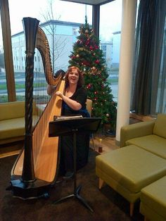 Second-year harpist, soprano and Music Scholar Emma Murton plays in the foyer of the new building during the afternoon, as guests arrive for the first Gala weekend events. Image: Hannah Perrin.