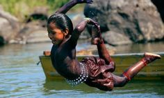 Guarani child jumping into river