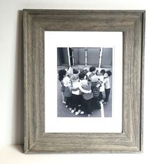 2016.  Framed black and photo of the class doing a group hug.