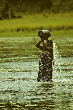 A woman cooling off after a hard day's work in the rice fields | Sri Lanka. #Indistay