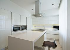 Astonishing Dining Space And Kitchen Design Of Kamenschiki Apartment Ivan Selvinsky With White Colored Dining Table