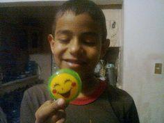 mi primer nieto hombre con su premio por buenas calificaciones..**