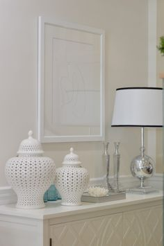 Hamptons style take on sideboard decor. Lots of whites and plenty of emphasis on texture