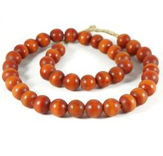 A gorgeous strand of 40 African Amber beads  imported from Ghana, W. Africa by Funky Frog.
