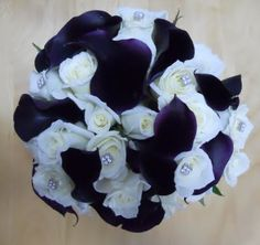 """Something like this for the centerpieces at the reception for """"night"""". More dark purple with some white for stars."""