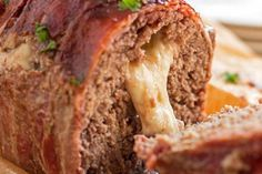 Try this Bacon Cheeseburger Meatloaf if you want to make a truly special dinner for your family! It's wrapped in bacon and stuffed with cheese for the ultimate homemade comfort food. Adapted from The Pioneer Woman. | #meatloaf #easydinner #comfortfood #groundbeefrecipes #bacon #cheese #cheeseburger #meatloafrecipe Venison Recipes, Meatloaf Recipes, Ground Beef Recipes, Homemade Meatloaf, Venison Meat, Bacon Wrapped Meatloaf, Bacon Cheeseburger Meatloaf, Deer Recipes, Pastries