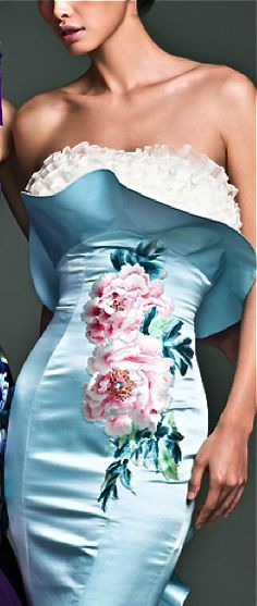 Unique and interesting formfitting pastel blue dress with english style rose detail and lace finishing