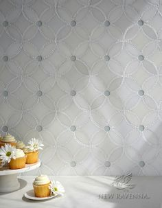 Esferitas, a stone and glass and waterjet mosaic, shown in honed Paperwhite, tumbled Thassos, and Tropical White glass. Designed by Paul Schatz for New Ravenna.<br /> <br /> For pricing samples and design help, click here: http://www.newravenna.com/showrooms/