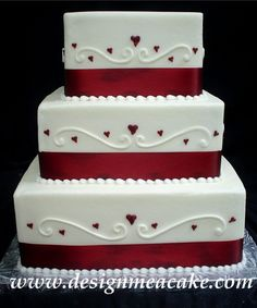 Wedding Cake - Simple buttercream finish....Burgundy ribbon... Swirls and hearts.
