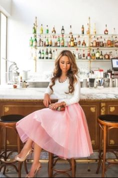 Such a pretty Pink + Tulle Skirt paired with a White Mid Sleeve Top. Amazing Curled Hair. Elegant, Classy, & Modest Outfit.