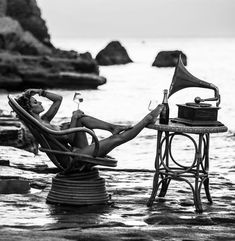 I love everything about this picture, relaxation, music, wine, water, oceanview....