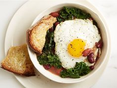 Bean, Kale and Egg Stew - olve oil (would reduce), red onion, kidney/pinto beans, low-sodium chicken/vegetable broth, low-sodium soy sauce, Kosher salt & black pepper, kale, eggs, whole-grain bread & cheddar (for serving), hot sauce of choice (for serving)