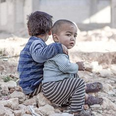 Esraa 4, and her brother, Waleed 3 near a shelter for internally displaced persons, in Aleppo Syria.