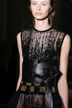 Valentino Fall 2014 Couture The Belt: Elegant ribbons of leather enlaced themselves around the girls at Valentino to make for a beautiful styling note and bring a sleek edge to supremely pretty gowns.