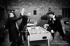 groomsmen playing table football