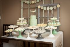 Gender neutral baby shower dessert table {prettymyparty.com} #babyshower #genderneutral #desserttable #parties