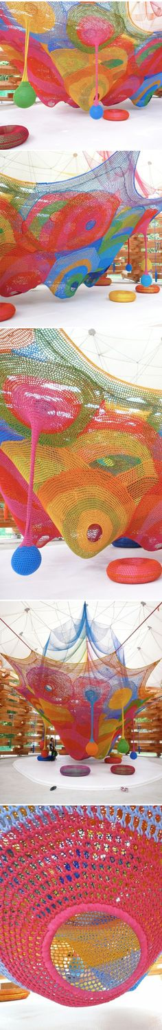 Crocheted art for children to play in. This amazing installation was created by Japanese textile and fibre artist Toshiko Horiuchi Macadam.