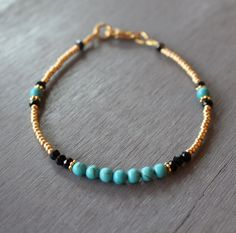 Turquoise and gold beaded bracelet, gold friendship bracelet, gemstone bracelet, beaded friendship bracelet, gold beads bracelet Elegantly styled turquoise howlite, gold beads and black Chinese crystals bracelet. A simple look to wear alone or stack with other bracelets. Goes casual or dressy, day into night. A bracelet youll reach for time and again. Gold plated lobster claw clasp and finished with wire guards for added durability. Comes in several sizes, please choose your desired size…