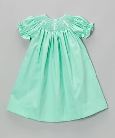 Nothing says childhood charm better than a classic bishop dress. Lovely embroidery and smocking add sweetness to its style, while the buttoned back provides an easy-on fit. A soft blend of fabrics offers undeniable comfort.
