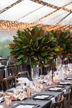 Magnolia leaves centerpiece - 17 Unexpected Ways to Decorate Your Wedding if You're Not Huge on Flowers – Magnolia leaves centerpiece Tall Wedding Centerpieces, Wedding Flower Arrangements, Flower Centerpieces, Floral Arrangements, Centerpiece Ideas, Wedding Decorations, Table Decorations, Floral Wedding, Wedding Flowers